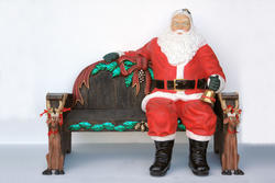 Santa Claus Sitting On Christmas Bench
